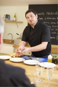 Chef Jack Scarterfield prepares scallops in the Culbone kitchen