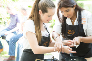 Kumud teaching a young people's cookery class