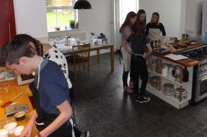 Teenagers learning to cook at Caboodle Cookery School